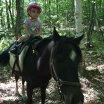 Kelsey riding Star in woods